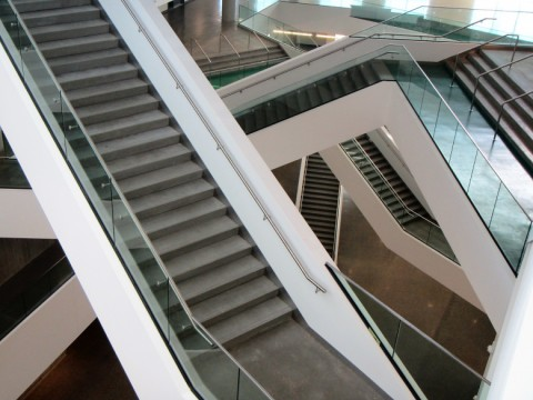 Stairs criss cross through Allard Hall's main atrium.